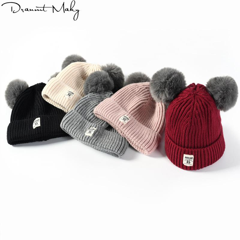 e93b748b5b1 2019 Fashion Cute Ages 2 8 Baby Hat Children Winter Hats For Girls Boy  Cotton Thick Warm Knitted Ears Beanie Double Ball Pompom Cap From Hougo