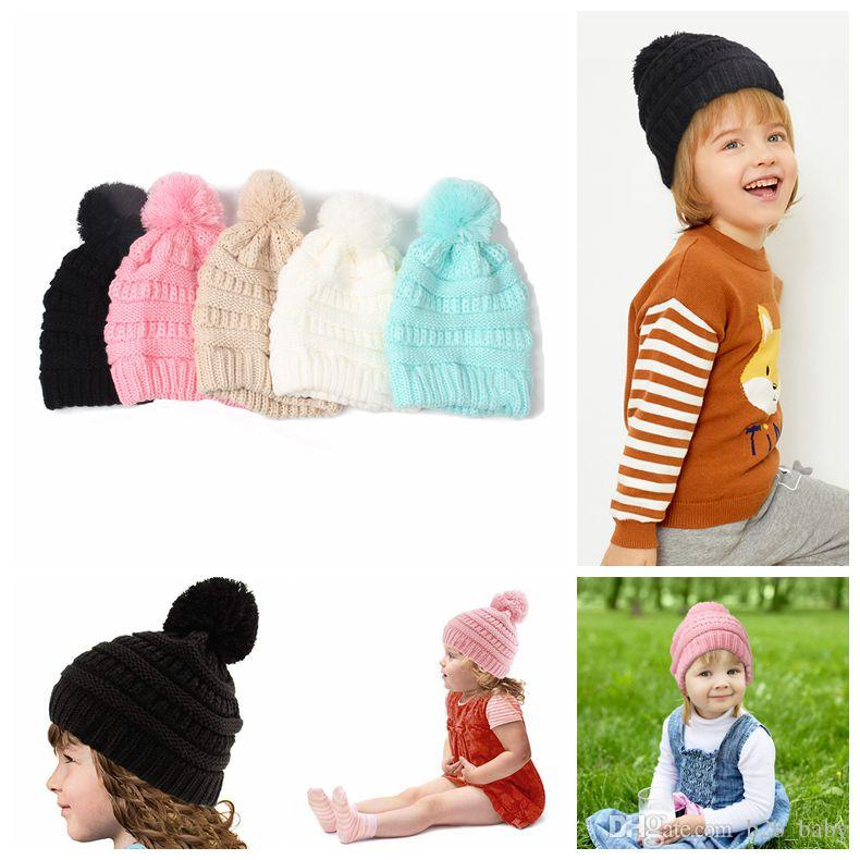 a336f4dfebf Kids Pompom Knitted Hats Kids Chunky Skull Caps Winter Cable Knitted ...