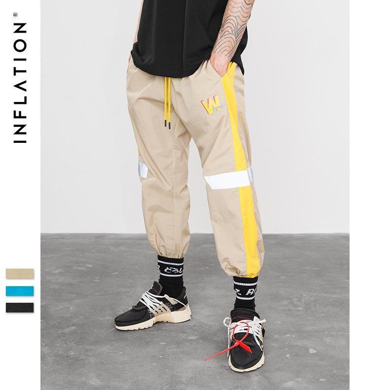 Acquista 18 Funzione Di Caramella INF Degli Uomini Riflettenti Pantaloni  Moda Cuciture Pantaloni Hip Hop Casual Pantaloni Sportivi Nuovo Stile  All ingrosso ... 7270c2dd24a1