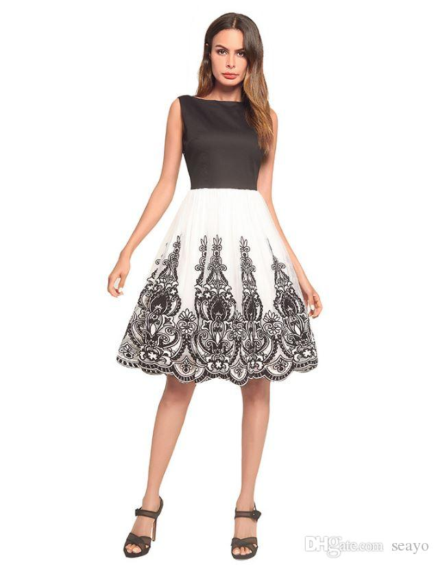 2018 summer new dress, European and American black and white net lace lace vest skirt, big pendant skirt, factory direct sale.