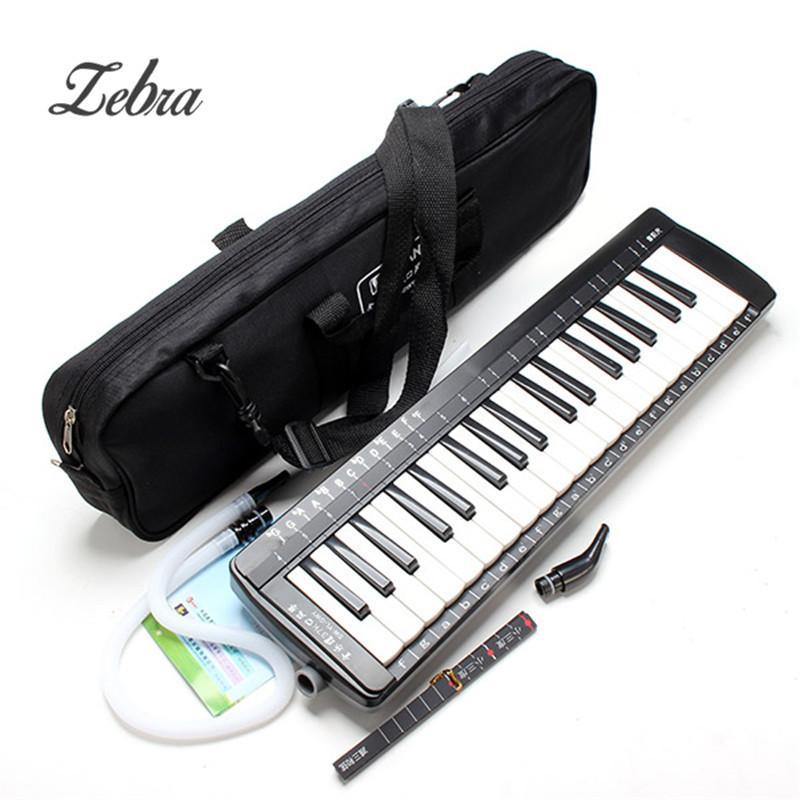 a0c1b26bf4d21 Compre Venta Al Por Mayor Instrumentos Musicales Instrumentos De Teclado  Piano SW 37K 37 Teclas Melódica Órgano De Boca Con Bolso A  67.05 Del  Tengdingmusic ...