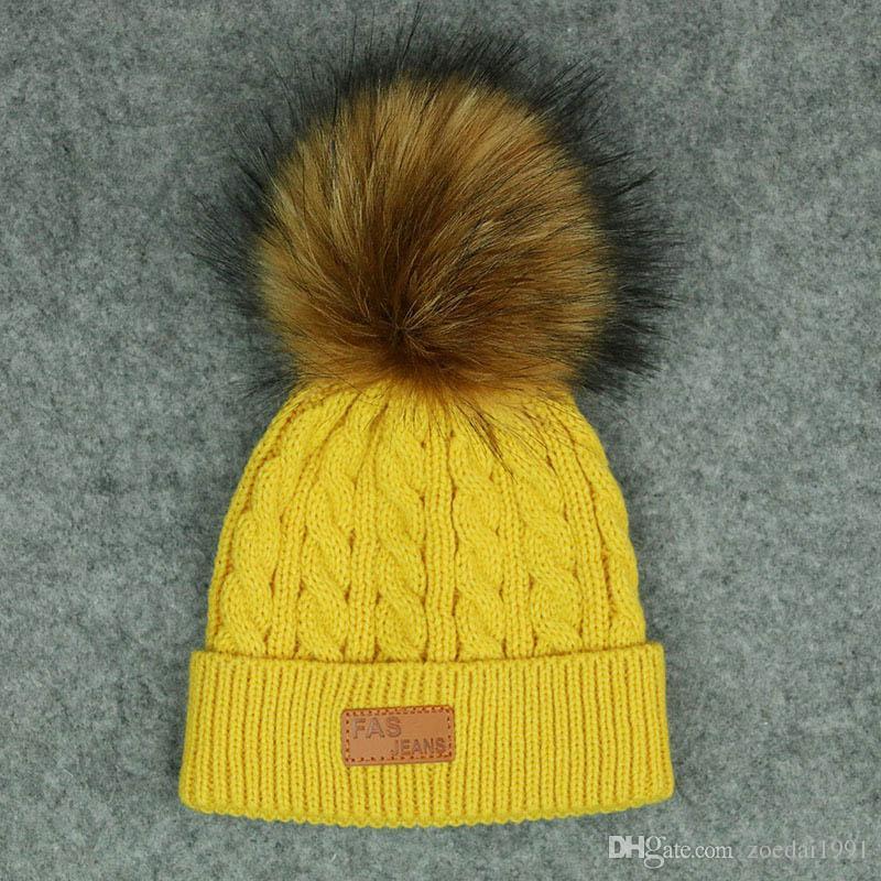 385e43607978b5 2019 New Children'S Fur Hats Baby Boy Girl Winter Ball Knit Raccoon Fur Ball  Caps Winter Ski Bean Bean Warm And Comfortable Slouchy From Zoedai1991, ...