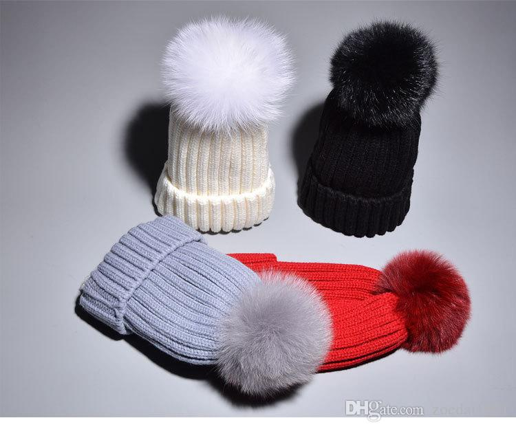 dce67dc6b83 2019 Kids Raccoon Real Fox Fur Pom Poms Hats Child Winter Knitted Beanies  Big Pompom Hats Boys Girls Child Warm Caps From Zoedai1991