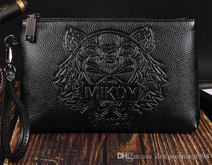 62289ae9b Compre 2018 Japón Y Corea Del Sur Diseñador De Moda Caliente Cabeza De  Tigre Bolso De Embrague De Cuero Suave Hombres De Gran Capacidad A $12.78  Del ...