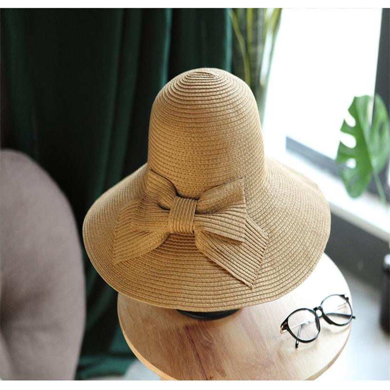 Summer Oversized Brim Sun Hat For Women Straw Weaver Sunscreen Female Caps  2018 New Arrival Elegant Striped Sun Hat YM D18103006 Fedora Hat Bowler Hat  From ... 271a6e88692e