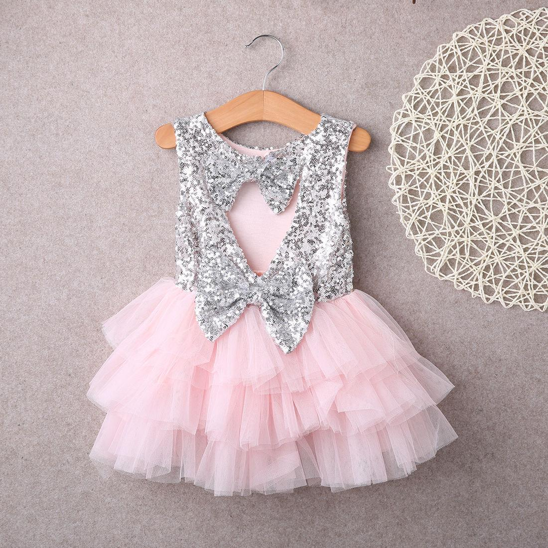 Bowknot Cake Dress Party Mini Ball Gown Dress Moda Baby Bambini Ragazze Abiti vestiti Paillettes Backless Bow Gold Lace Dress