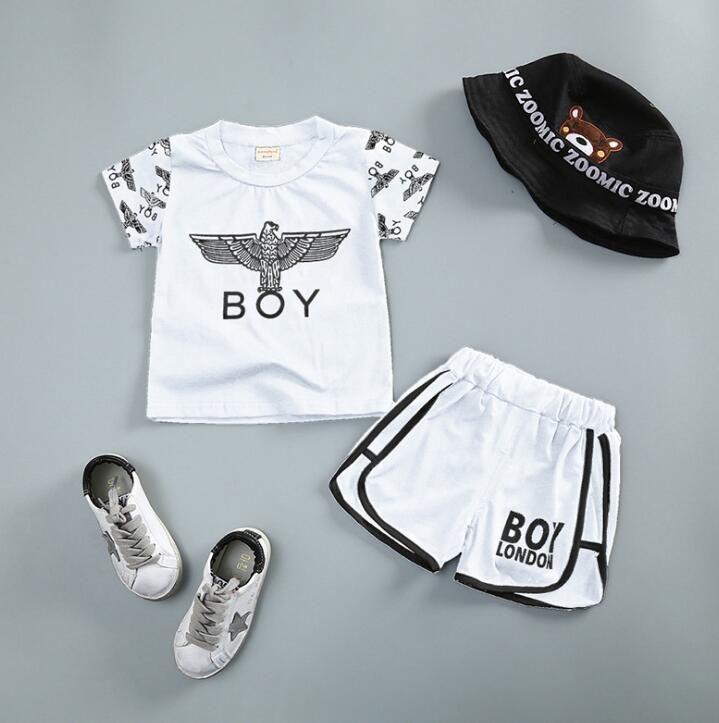 2018 bebés de verano para niños ropa conjunto bebés niños algodón Tops Tee camiseta + Shorts Boy Set niños trajes blanco negro 3938