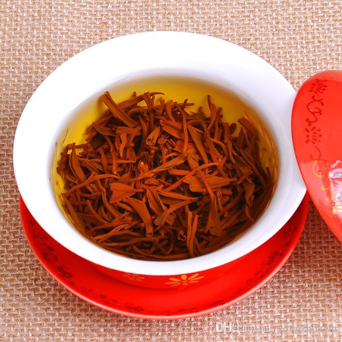 250g Promotions! Nouveau thé au miel de qualité supérieure au miel noir, petits bouts jaunes en vrac au printemps! Thé chinois de haute qualité! Livraison gratuite
