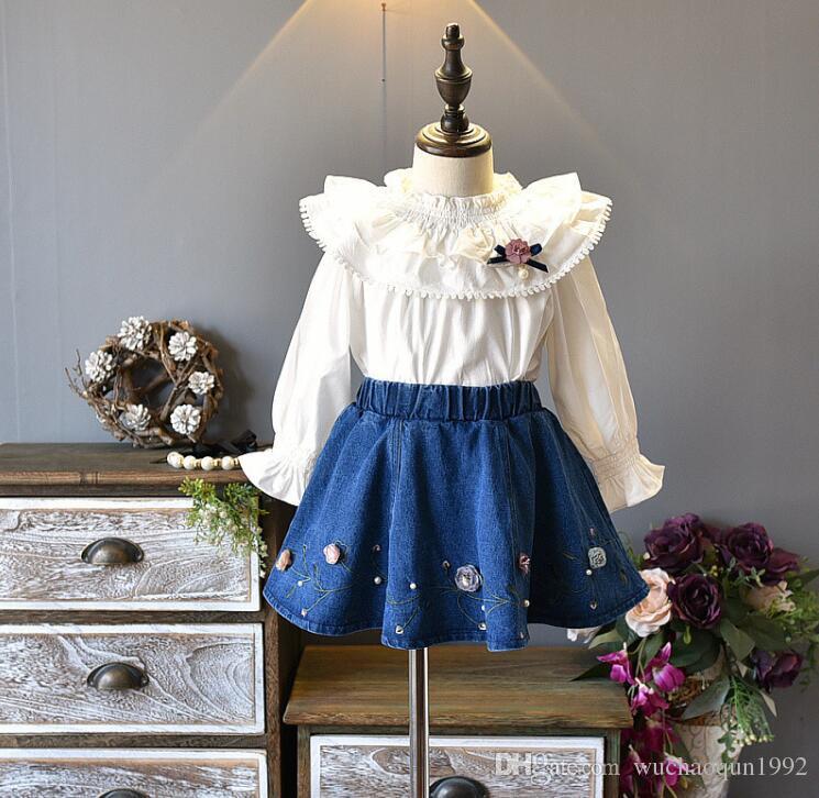 1c37f37de6e3 Compre Otoño 2018 Nueva Moda Coreana Niñas Boutique Trajes 2 Unids / Set Camisas  De Manga Larga + Faldas De Mezclilla Princesa Traje De Los Niños Ropa Para  ...