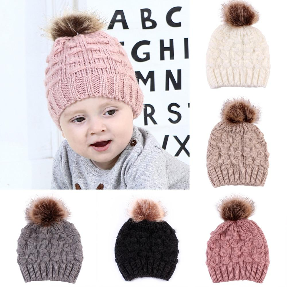 2554faad3c0 2019 Puseky Newborn Baby Kids Boys Girls Knitted Crochet Winter Warm Hat  Fur Ball Pompom Hats Solid Color Knit Wool Beanie Caps From Humom