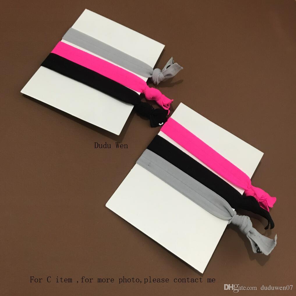 6 pçs / lote 2 packs Nova cor brilhante 2C moda símbolo elástico laços de cabelo com Nó banda De Cabelo de luxo pulseiras corda acessórios presente do VIP