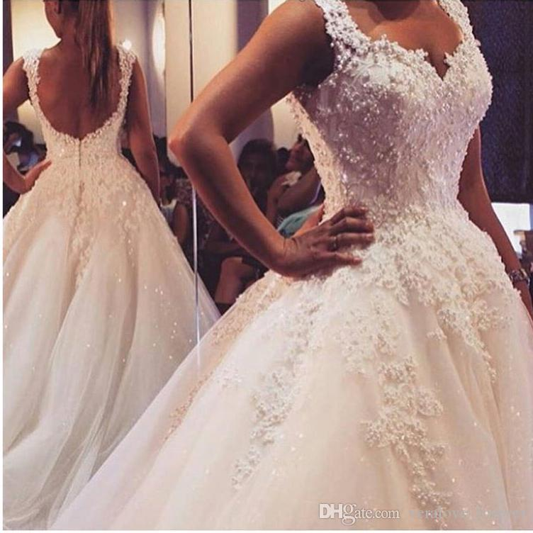 aa02af4793a7 Discount New Lace Wedding Dresses Spring 2018 Backless Beaded Ball Gowns  Bridal Gown With Flowers Lace Applique Luxury Wedding Gowns Best Wedding  Dresses ...