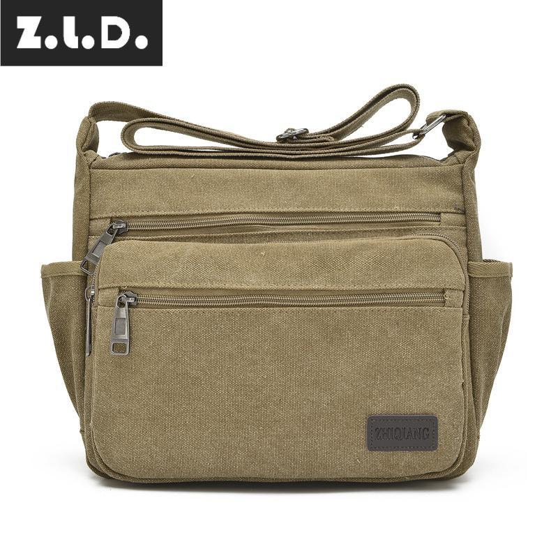 Z.L.D. New Men S And Women S Diagonal Bag Retro Canvas Bag Messenger Large  Capacity Multi Function Street Daily Necessities Womens Bags Camo Purses  From ... aaeee8be2a