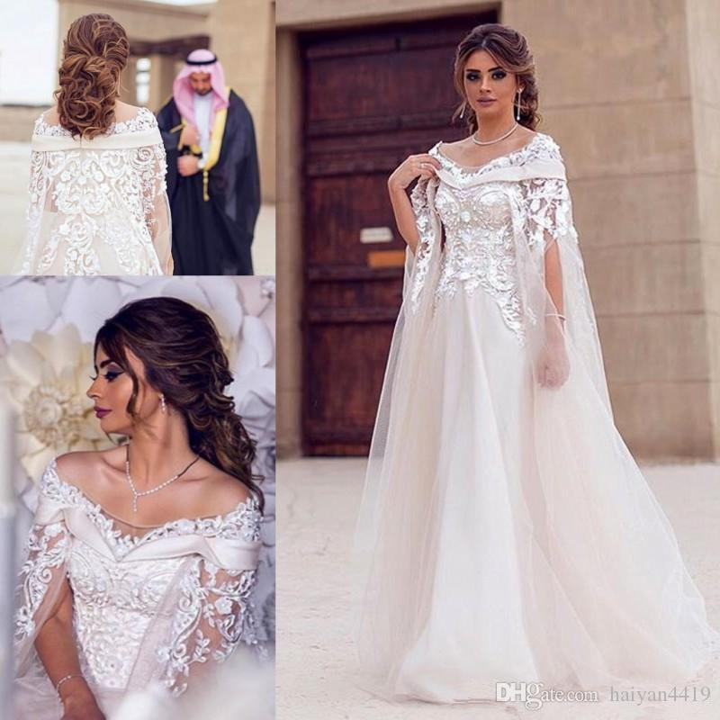 378d9debfc4 Discount 2018 A Line Wedding Dresses Dubai Off Shoulder With Wrap Cape Style  Lace Applique 3D Flowers Beaded Sweep Train Arabic Formal Bridal Gowns  Wedding ...