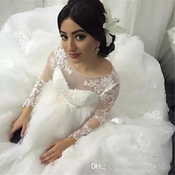 Precioso vestido de novia Vestido de novia Cuello de joya transparente Vestidos de novia de tul hinchado Apliques de encaje Mangas largas transparentes Vestidos de novia