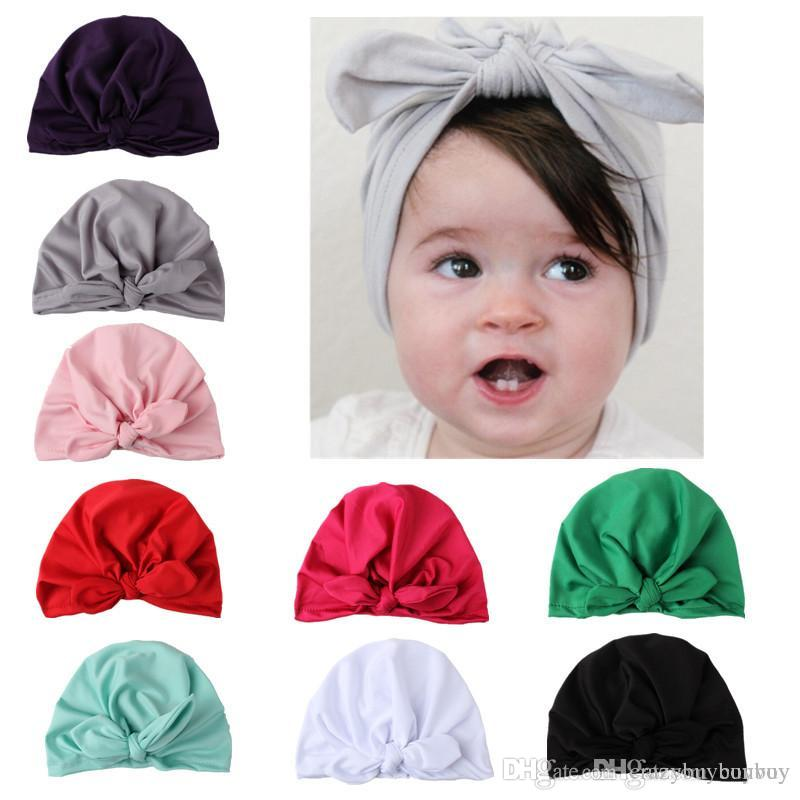 New Europe US Baby Hats Bunny Ear Caps Turban Knot Head Wraps Infant ... 1c95b53ea4a6