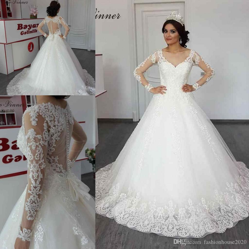 ab54ccfb4 Discount 2018 Cheap Arabic Wedding Dresses A Line V Neck Lace Appliques  Beading Crystal Illusion Long Sleeves Open Back Plus Size Formal Bridal  Gowns ...