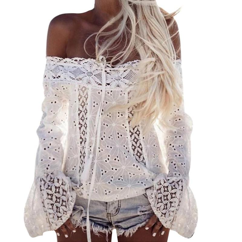 ca399ed1ee0f9 2019 Sexy White Lace Blouse Shirt Women Fashion Off Shoulder Top Slash Neck  Flare Sleeve Female Blouses Summer Hollow Out Tops From Wanglon05