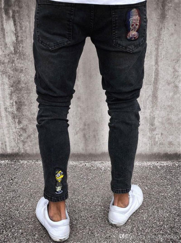 Compre Pantalones Vaqueros Para Hombre Elasticos Ripped Skinny Biker Jeans Patron De Dibujos Animados Destruido Con Cinta Ajustada Slim Denim Pantalones A 17 38 Del Hotsell666888 Dhgate Com
