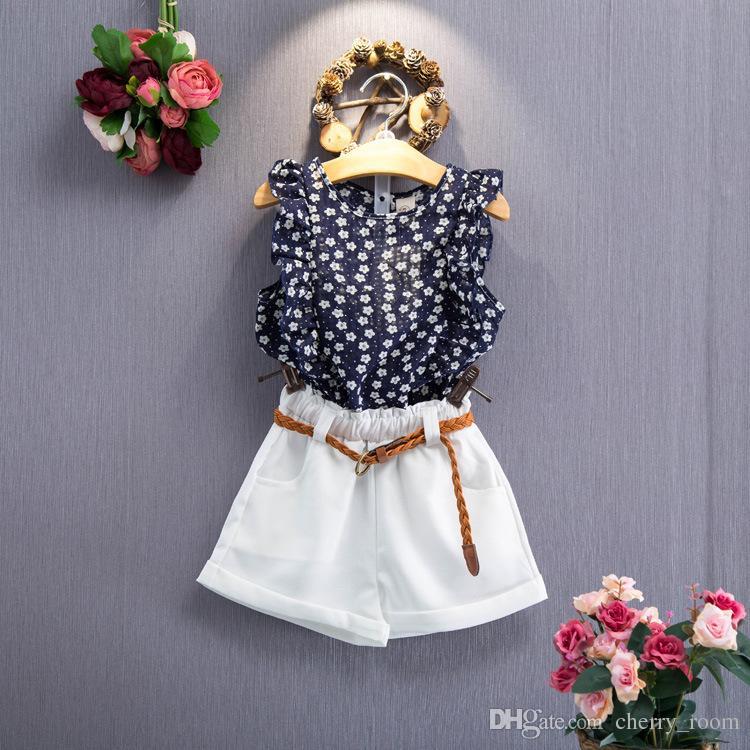 Корейский Pricness наборы наряд девушки одежда набор Lotus воротник рукавов цветочные топы + белые шорты с поясом для девушки летние наборы A9007