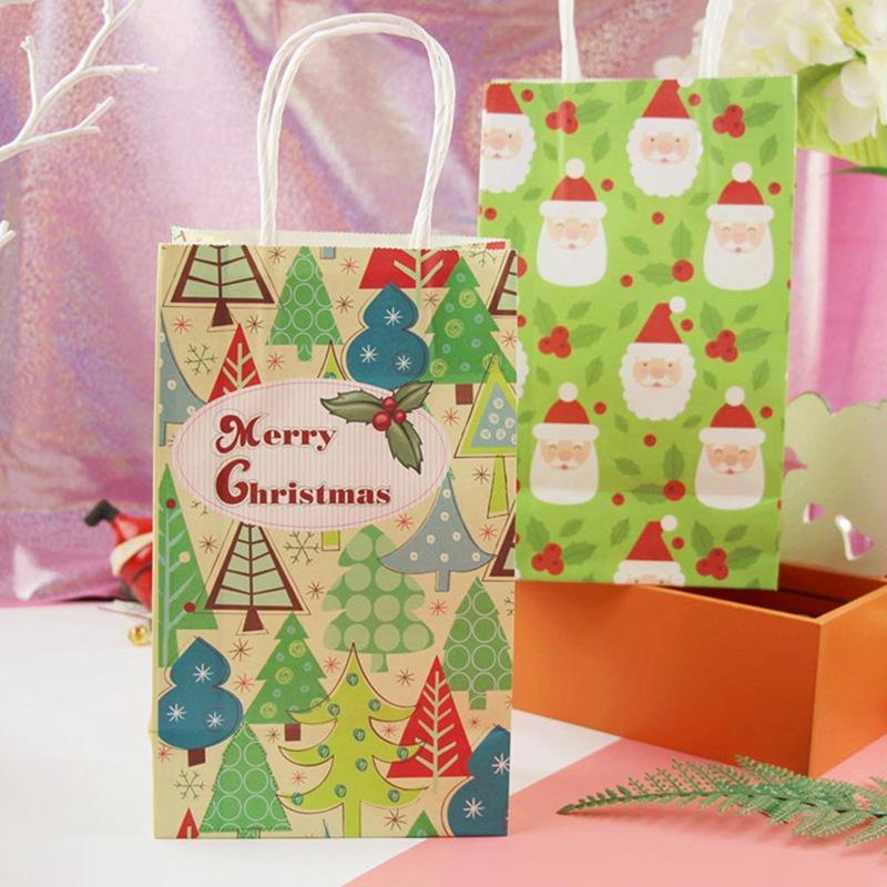 78c4fa25397bd Großhandel 21x13x8 Cm Frohe Weihnachten Geschenk Tasche Mit Griff  Dekoration Kraftpapier Tasche Schöne Weihnachtsbaum Weihnachtsmann Papier  Von Starch