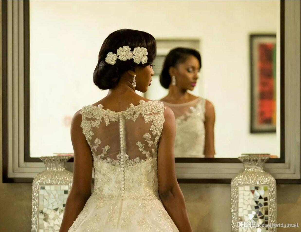 Vestidos de matrimonio Vestidos de novia magníficos Sheer Cuello redondo Sudafricanos Apliques de encaje Vestidos de novia Árabe Dubai con botón en la espalda