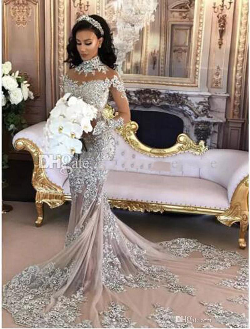 Sexy vestido de novia de manga larga de plata de sirena Sheer Cuello alto apliques de lentejuelas con cuentas vestido de novia de Arabia Saudita cubierto Botton Volver