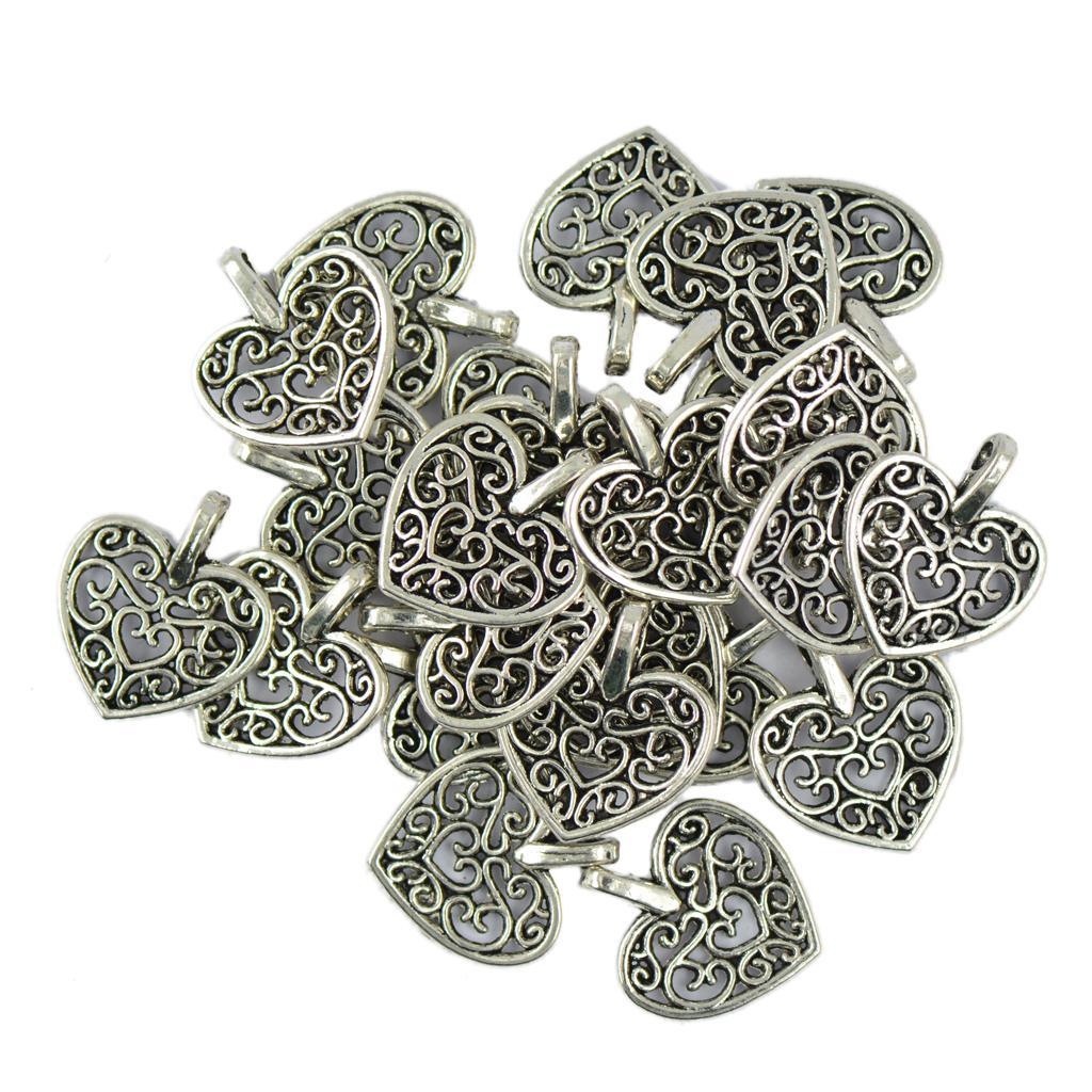 9b20ab220f08 Compre 50 Unidades   Paquete De Plata Tibetana Filigrana Corazón Encantos  Colgantes DIY Fabricación De Joyas Para El Collar Pulsera De Resultados A   32.71 ...