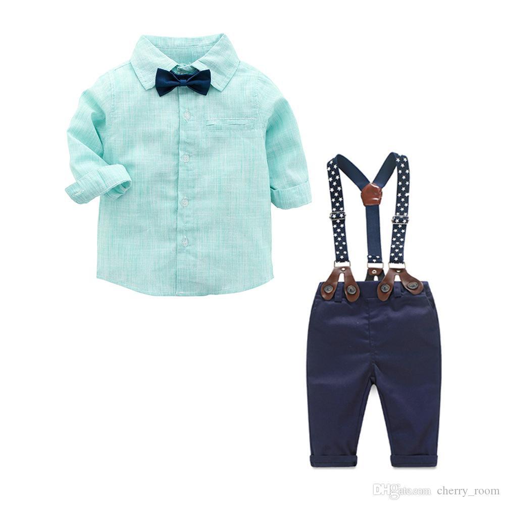 Compre Primavera Para Niños Bebés Trajes De Caballero INS Ropa Para Niños  Pequeños Set Plaid Tie Bow Camisa De Manga Larga + Lunares Correa  Pantalones ... 891a7b7f2e99