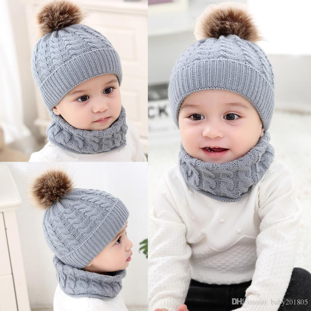9e008f6466f 2019 Baby Hat Scarf Winter Fur Ball Knitted Warm Newborn Beanie Solid Color  Protect Ear Cap O Ring Scarves Cap Bonnet From Baby201805