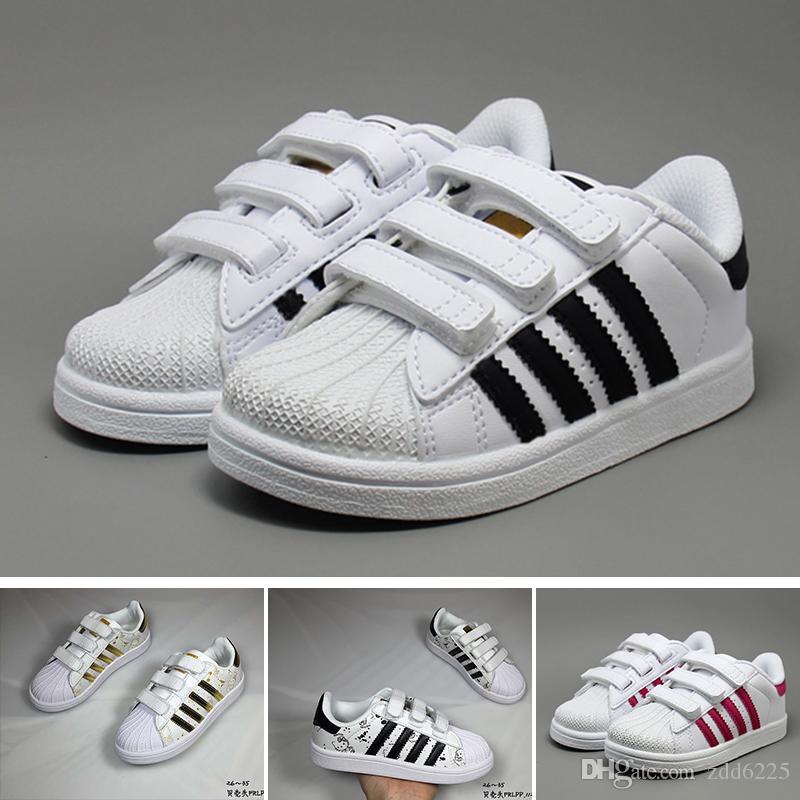 huge selection of 81f4e 69fd7 Compre Adidas Superstar Superstar Calzan Los Zapatos De Las Zapatillas De  Deporte De Las Superestrellas Originales De Los Niños Del Bebé Del Oro  Blanco ...