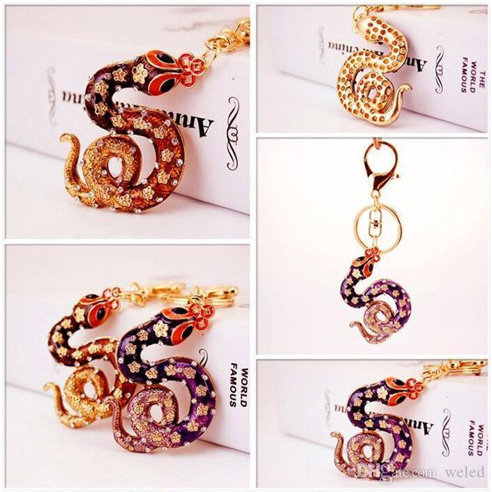 Snake Crystal Keychain Keyring Womens Bag Charm Handbag Pendant Car Key  Chians Holder Creative Lucky Gift Paracord Lanyard Keychain Access From  Weled e5f042815a
