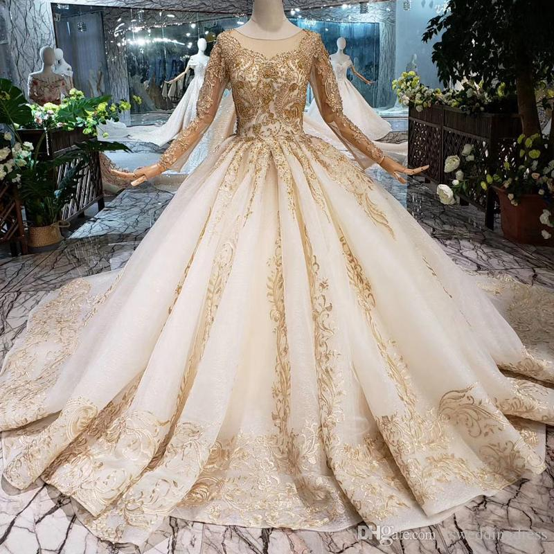 2019 Newest Design Dubai Wedding Dresses Luxury Gold Applique Long Tulle  Sleeve Wedding Gowns Illusion O Neck With Veil Beaded Bridal Gowns Mature  Bride ... d2faabbe5d4a