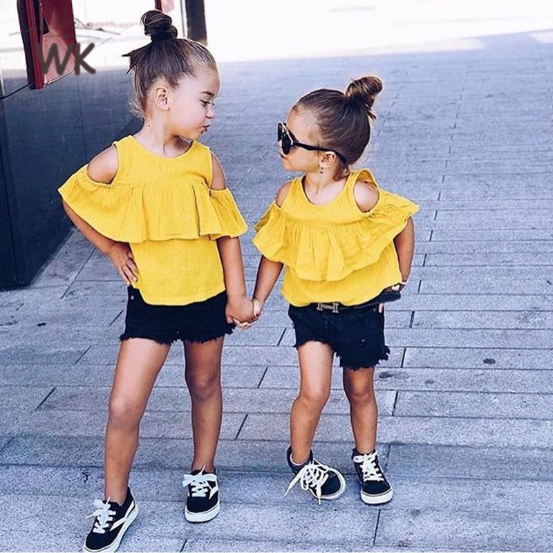 1ce770ac9 Compre Nueva Ropa De Verano Para Niñas 2019 Diseño De Volantes De Moda Top  + Shorts Ropa De Niña Establece Ropa Para Niños Set 2 6T JT 369 A $33.15  Del ...