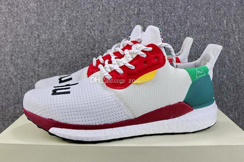 eb4d41787729e Compre Humana Raça Pharrell Williams X Solar Hu Glide Pacote ST Ouro Ousado  Verde Sapatos De Corrida Homem Tênis Autênticos 36 45 De Zoeystore