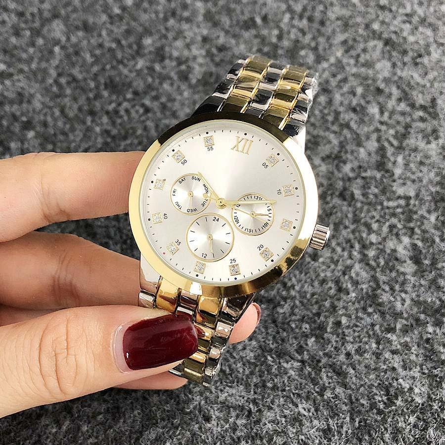 Orologio di modo di marca la ragazza 3 Dials stile d'acciaio del quarzo della fascia di metallo delle donne orologi TOM6670