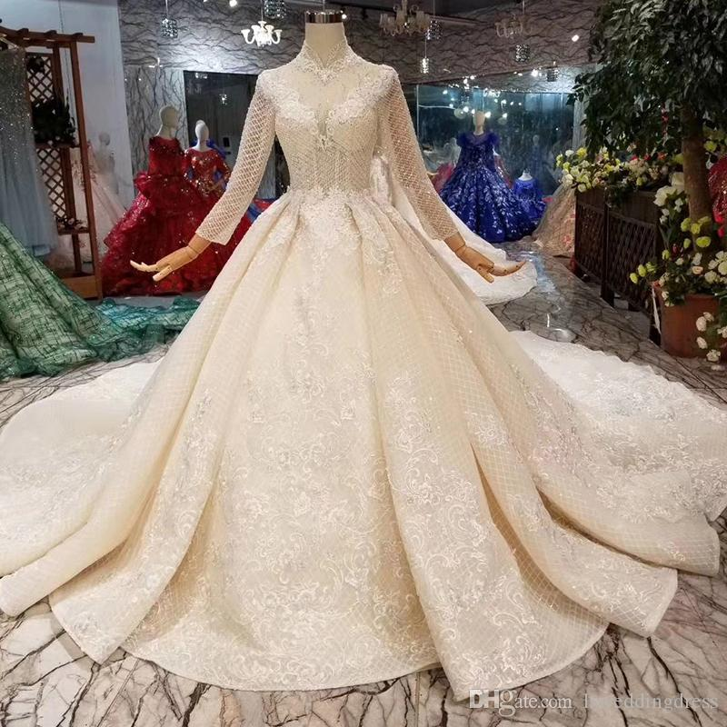 Illusion Long Sleeves Wedding Dresses High Neck Open Keyhole Back Sexy Wedding Gowns Lace Appliques See-Through Bridal Wedding Dress Dubai