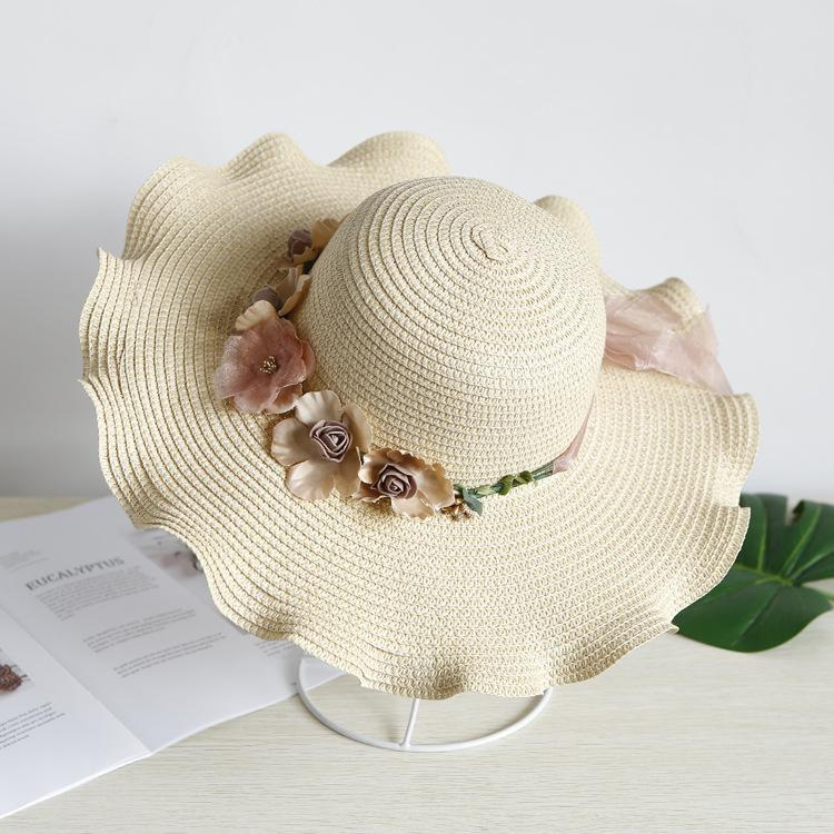 1102845f46054 Compre 2019 Versión Coreana De Flores De Primavera Y Verano Sombreros De  Paja Señoras Protector Solar Lindo Sombrero Grande Sombrero De Sombrilla  Lateral ...