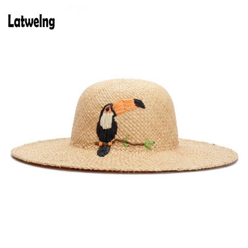 360903159 2018 Women Straw Hats Panama Sun Visor Hat New Handmade Raffia Cartoon  Woodpeck Embroidery Wide Large Brim Beach Hat Fashion Cap C18122501