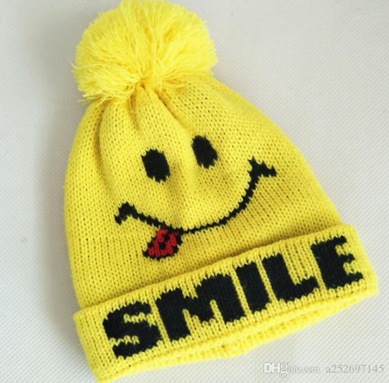 1fe10382629e5 Children Knitted Hats Lovely Yellow Smiley Face Woollen Hats Men And Girls  Autumn Winter Warm Hats Big Hair Ball Wholesale Cap Online Starter Cap From  ...