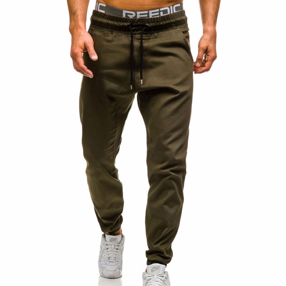 e2c78783b1354 Compre Nueva Moda Masculina 2019 Delgado Color Sólido Hombres Pantalones  Casuales Hombre Pantalones Diseñador Mens Joggers A  22.85 Del Maternal kid  ...