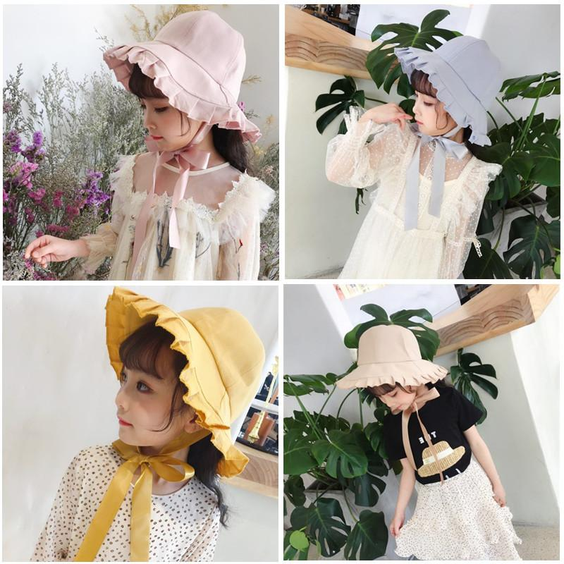 66c1377f 2019 Baby Hats Korean Children Big Ruffle Brim Cotton Bucket Hat Fisherman  Hat Boy Girl Basin Sunscreen Windproof Fitted Hats Designer Caps Cap From  ...