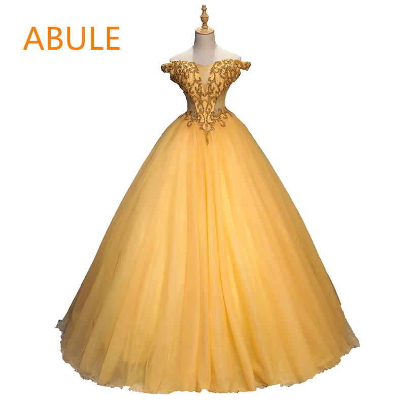 c7320d1e3180c wholesale Quinceanera Dresses 2018 srtapless lace up Gold ball gown prom  dress appliques Gown 15 Years Layer Tulle Custom