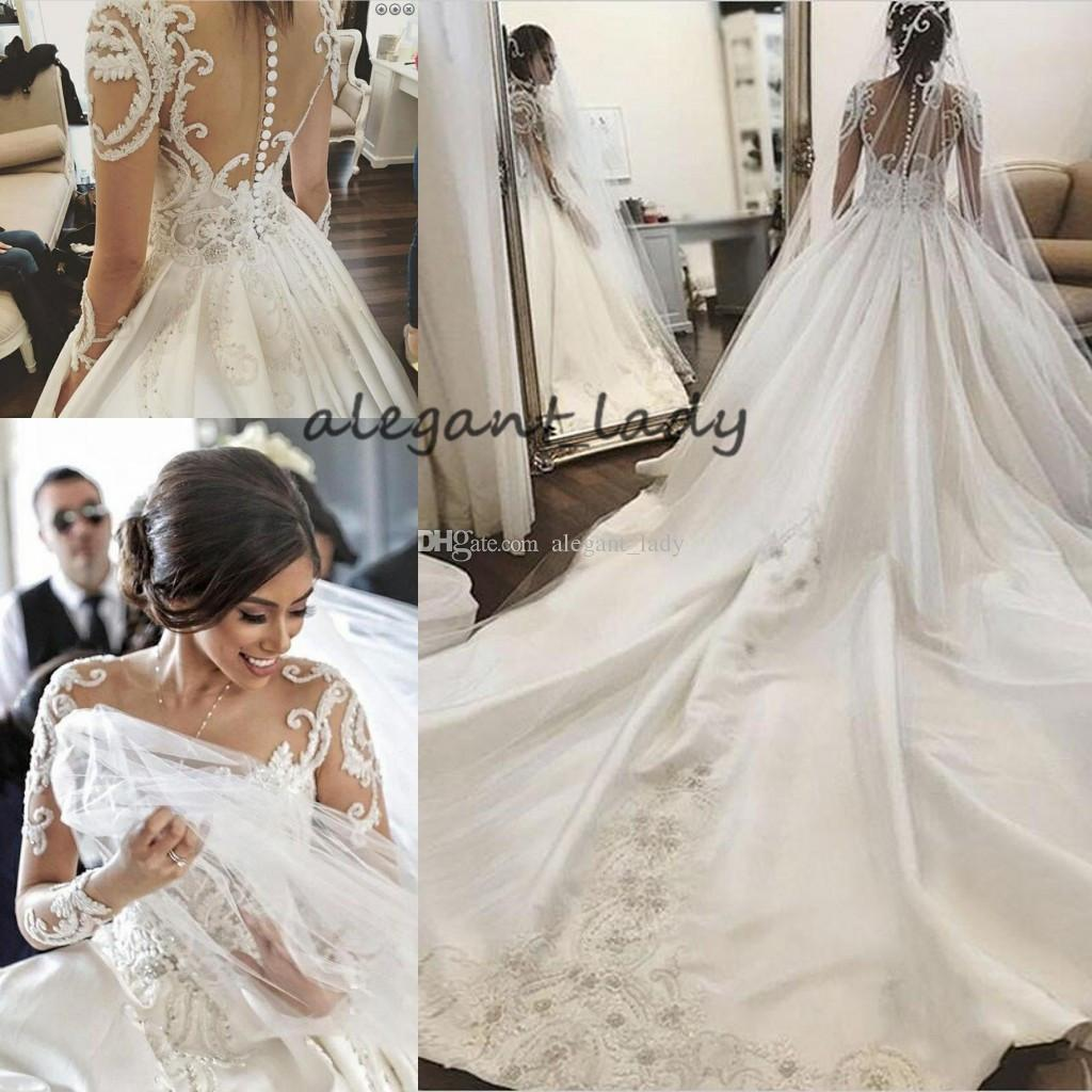 Round Neck Long Sleeves Chapel Train Wedding Dresses 2019 Luxury Lace Applique Middle East Arabic Princess Church Royal Wedding Gown Veil