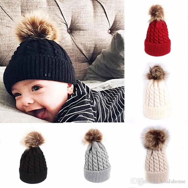 New Baby Winter Hat Cap Pompom Knitted Infant Kids Hat Newborn Baby Girl  Boy Hat Toddler Ear Warm Beanie Children Caps Headwear Beanies For Men From  ... a3ffe96a5a5