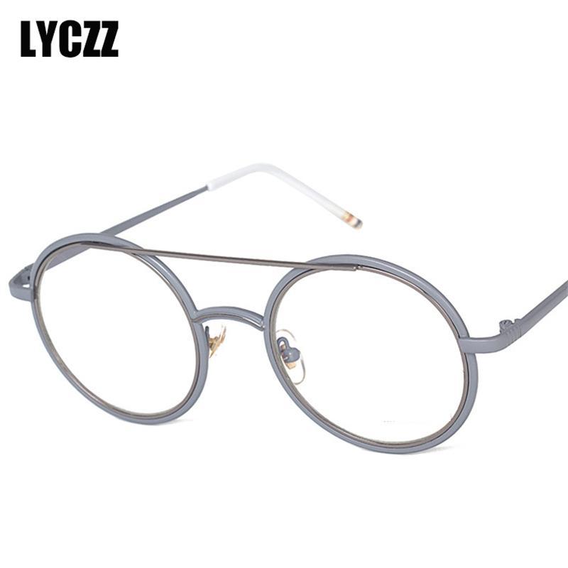 cd25bf3953ed4 2019 LYCZZ Retro Optical Frame Women Round Metal Glasses Transparent Men  Fashion Reading Glasses Frames Myopia Clear Prescription From  Marquesechriss