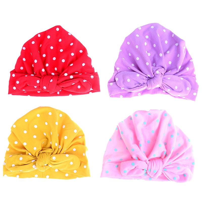 2d79690d1e3 Candy Color Sweet Baby Girl Bowknot Hat With Dot Baby Cap For Girls Turban  Elastic Hat Hair Accessories UK 2019 From Bradle