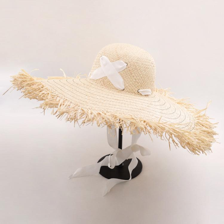 42b3c790 Wholesale Wide Brim Sun Hats For Women Raffia Straw Summer Hat Floppy Hat  With Cross Ribbon Tie Beach Hats With Fray Edges Funny Hats Hat World From  ...