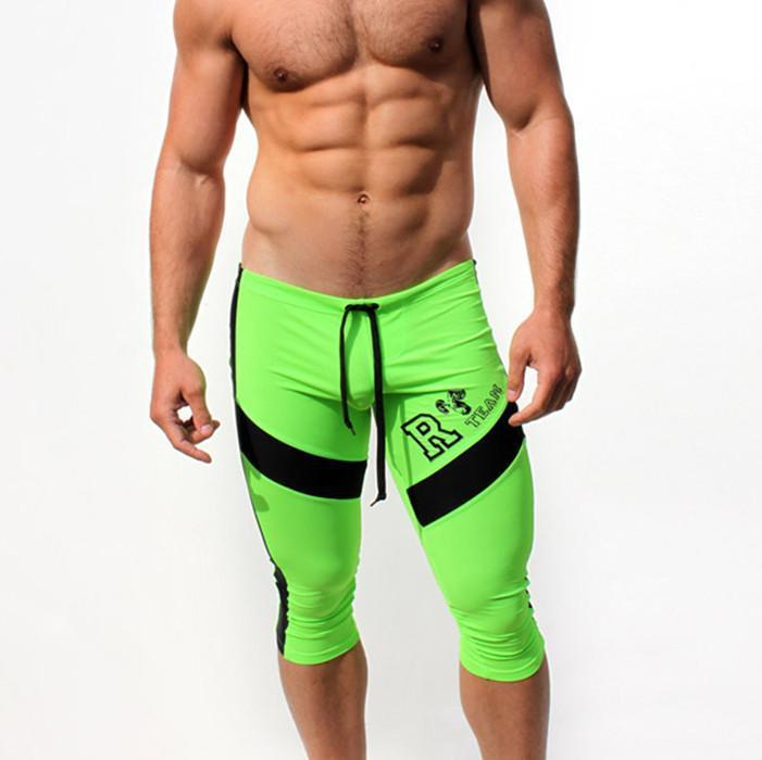 59c02a912c17 JIGERJOGER 2018 new acid green orange men's sports Legging fitness capris  shorts tight fast dry stretch swimming trunks Gym pant