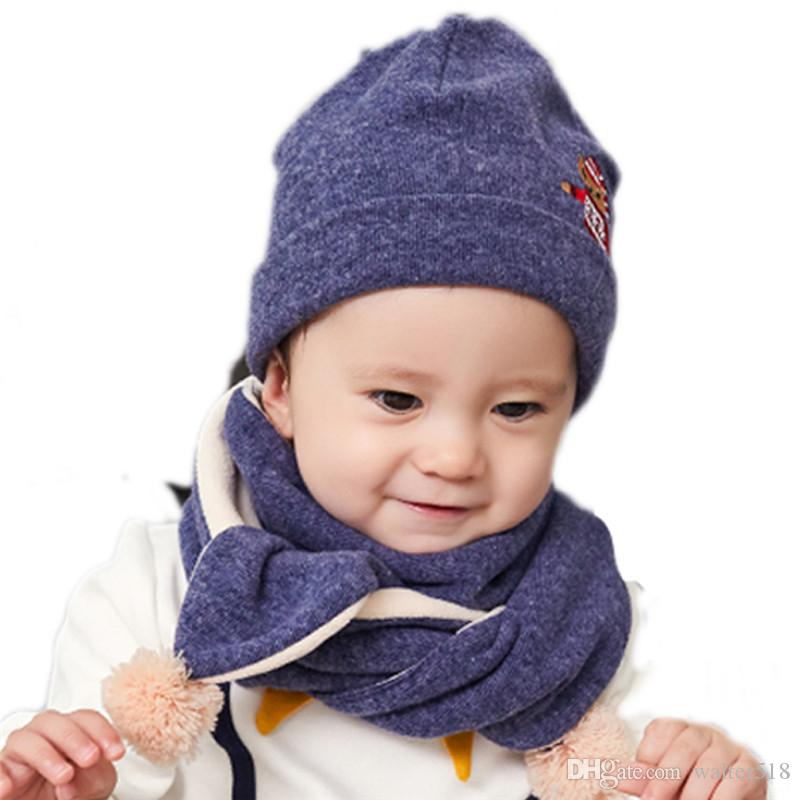 cb1456ab7a9 2019   Set Baby Hat Scarf Set Baby Winter Cap Child Beanie Bonnet Warm Hats  With Neck Warmer For Children Animal Print NM 012 From Walter518